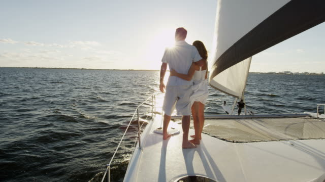 Young Caucasian couple living healthy outdoor yacht lifestyle Smiling Caucasian couple male female enjoyment happy togetherness ocean yacht financial planning holiday leisure adventure travel RED EPIC financial planning stock videos & royalty-free footage
