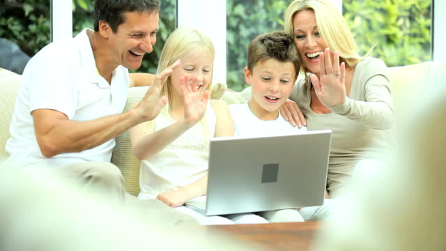 Young Caucasian Family Using Online Webchat video