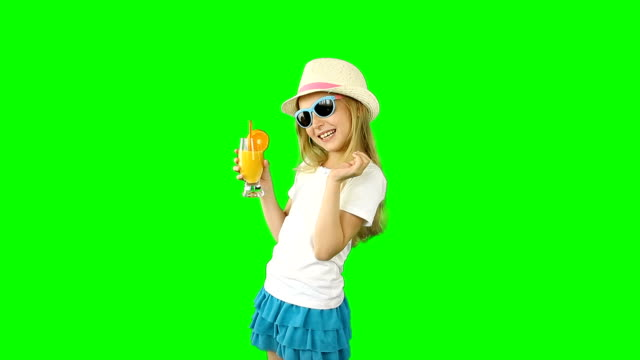Young caucasian girl walking and drinking orange juice. Thumbs up gestures show. video