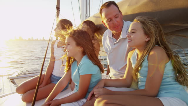 young caucasian girls and parents sailing on yacht - financial planning stock videos & royalty-free footage