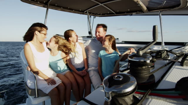 young caucasian girls and parents steering ocean yacht - financial planning stock videos & royalty-free footage