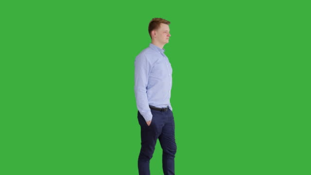 Young Caucasian Man Standing against Green Screen Background. Male Person Isolated on Chroma Key. Casual Business Professional Portrait video