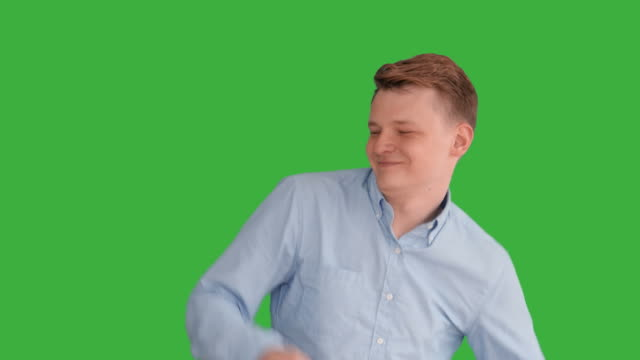 Young Caucasian Man Standing against Green Screen Background. Male Person Isolated on Chroma Key. Casual Business Professional Portrait
