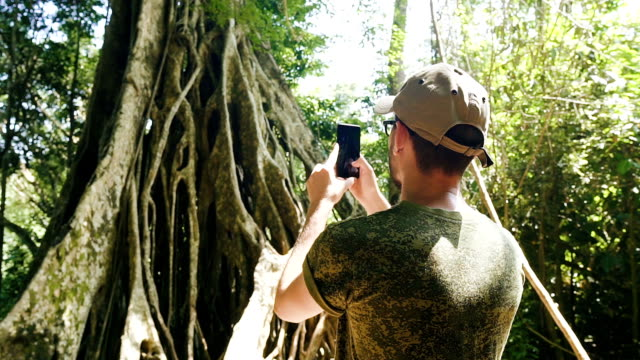 Young caucasian man using smartphone