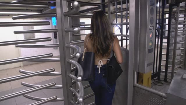 Young Caucasian Woman With Long Brunette Hair Walks Into The New York City Subway System Through A Turnstile Young Caucasian Woman With Long Brunette Hair Walks Into The New York City Subway System Through A Turnstile new york city subway stock videos & royalty-free footage