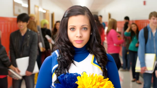 Young cheerleader in hallway video