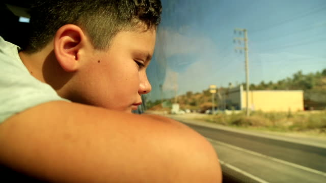 Young child looking out bus window video