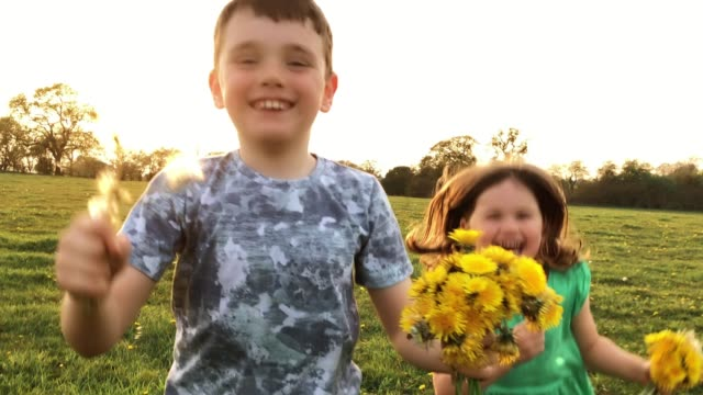 Young children laughing and playing during the Easter break video