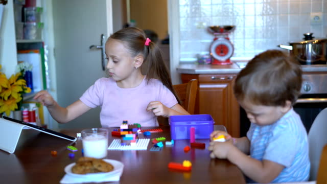 young children playing with plastic blocks at home. - brother stock videos and b-roll footage