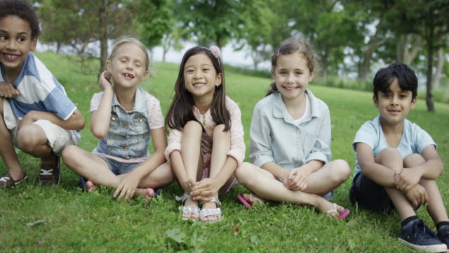 Young Children Sitting Together Outdoors video