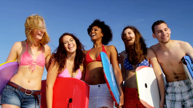 Young College Students Body Boards Enjoying Weekend Break