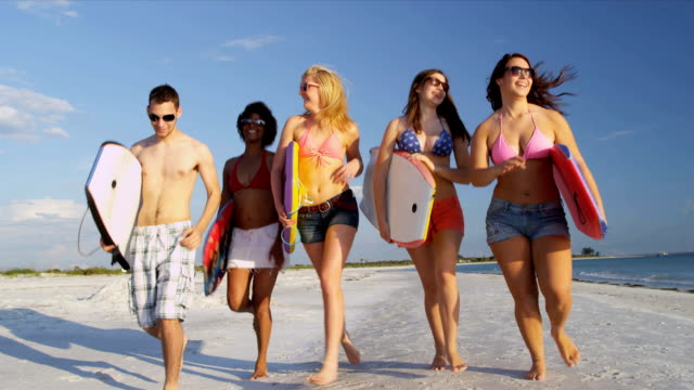 Young College Students Body Boards Enjoying Weekend Break video