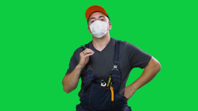 Young construction worker with N95 face mask looking at camera