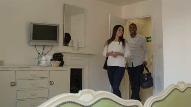 Young Couple Arriving In Boutique Hotel Room Shot On R3D video
