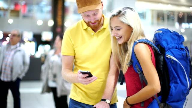 ungt par på en flyg plats. - blue yellow bildbanksvideor och videomaterial från bakom kulisserna