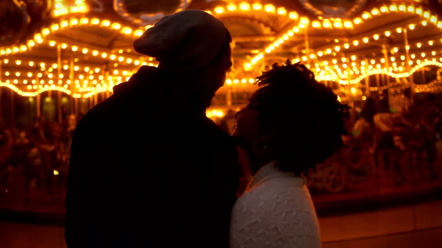 Young Couple at Carousel -Uberstock- HD 1080p- date night romance stock videos & royalty-free footage