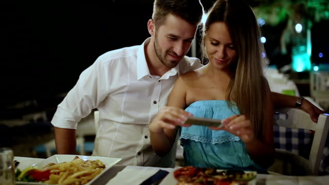 Young couple at dinner in a restaurant video