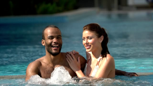 Young Couple at the Swimming Pool