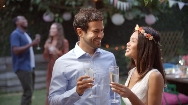 Young Couple Celebrating Wedding With Party In Backyard video