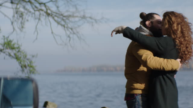 Young couple cuddling by the lake video