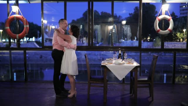 Young couple dancing in restaurant at night Young couple dancing in restaurant at night date night romance stock videos & royalty-free footage