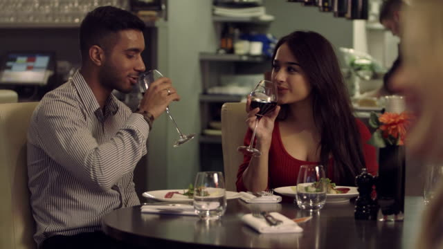 MS Young couple drinking wine in restaurant video