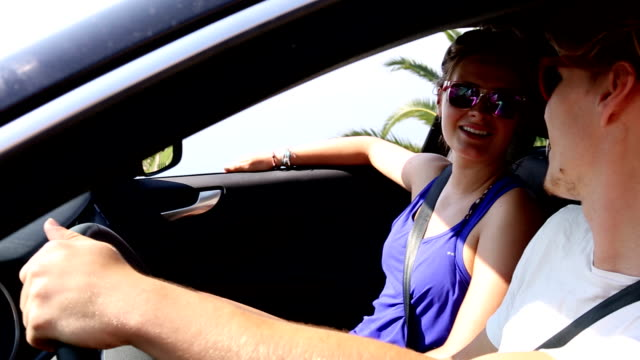 Young couple drive to viewpoint, then stop car to enjoy view video