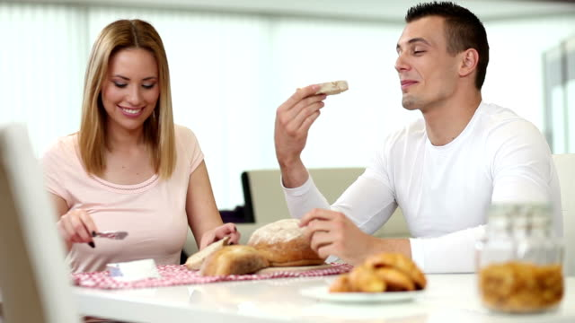 Young couple eating breakfast video