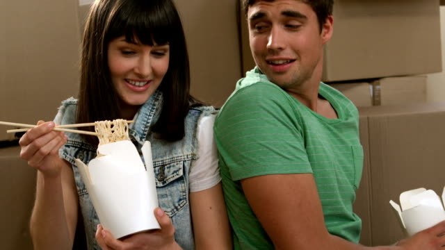 Young couple eating Chinese meal video
