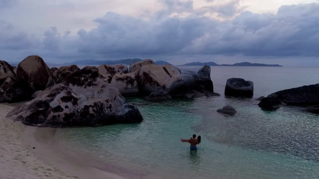 Young couple embracing at tropical beach, Virgin Gorda