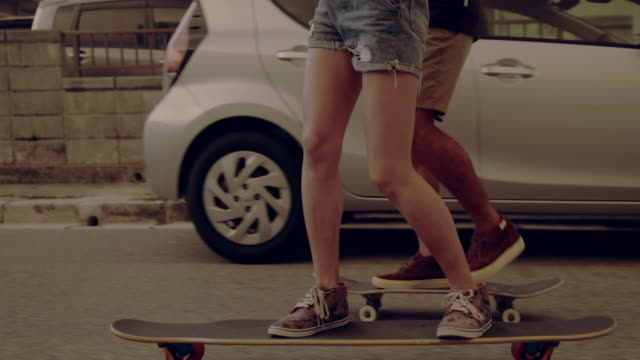 Young couple enjoy skateboarding. Young couple enjoy skateboarding. skateboarding stock videos & royalty-free footage