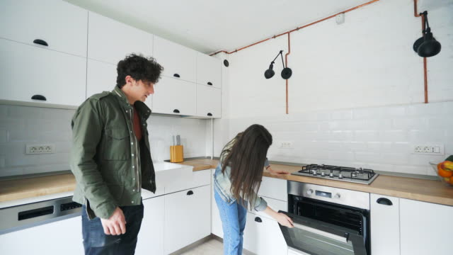 young couple enjoying a new place to live in. - proprietario d'immobili video stock e b–roll