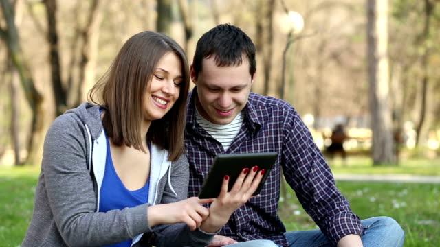 Young couple enjoying outdoor video