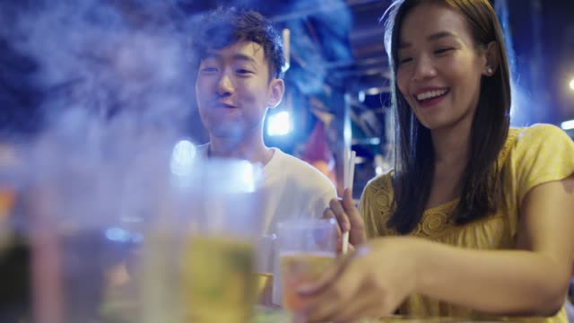 young couple enjoying street food - date night stock videos & royalty-free footage