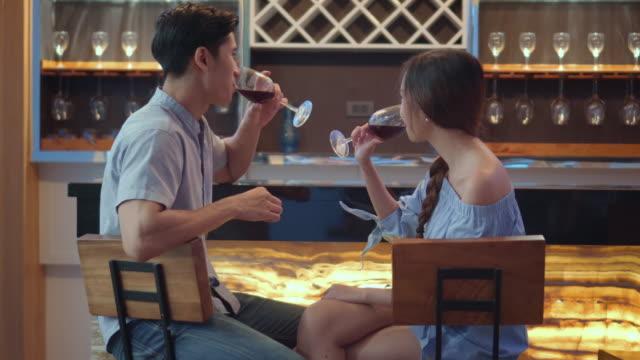 Young couple enjoying wine