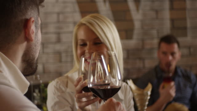 Young Couple Enjoys With Glass of Red Wine 4K slow motion video