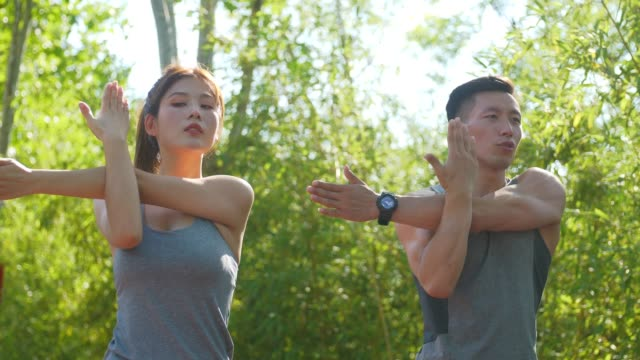 Young  couple exercising in a park