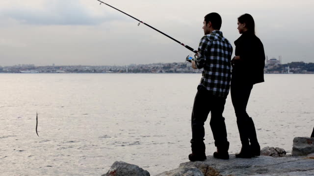 Young couple fishing in Istanbul video