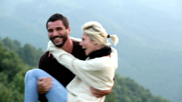 Young couple flirting on mountain video HD video