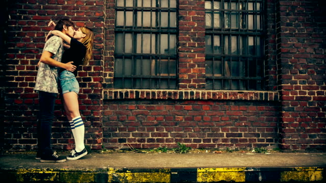 Young couple fooling arround and having fun Young couple fooling arround and having fun in vintage color correction kissing stock videos & royalty-free footage
