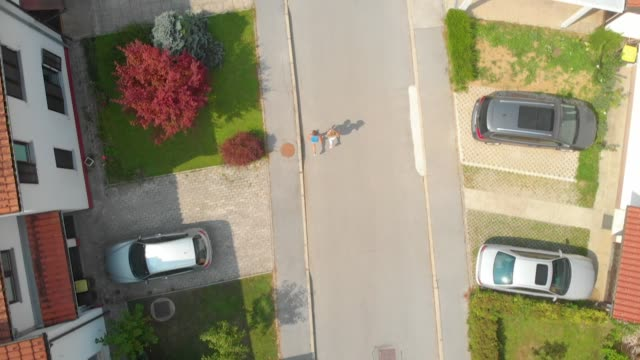 TOP DOWN: Young couple going for a jog through the idyllic suburban neighborhood video