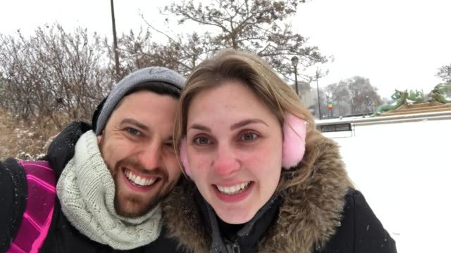 Young couple having fun after snowing