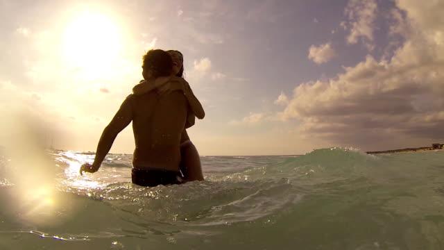 young couple having fun in the sea video