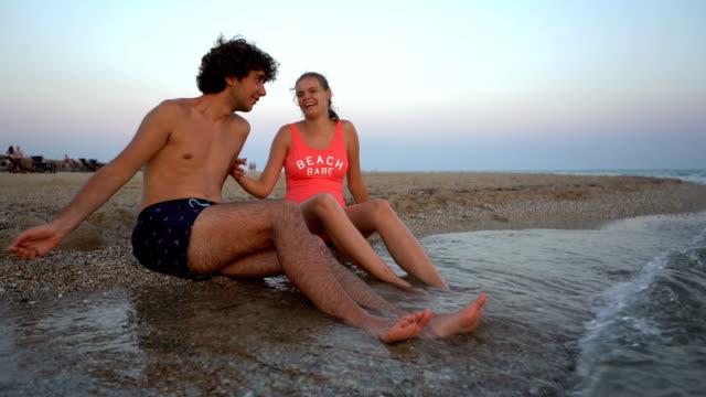 Young couple having fun on beach