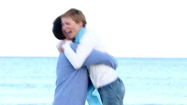 young couple having fun on the beach video