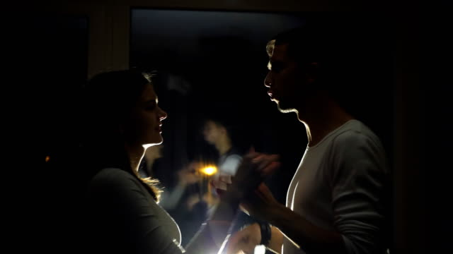 young couple having relationship difficulties during night - walczyć filmów i materiałów b-roll