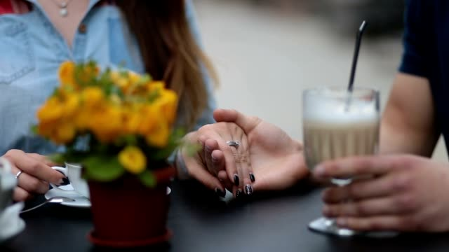 young couple holding hands at the cafe, closeup - date night stock videos & royalty-free footage