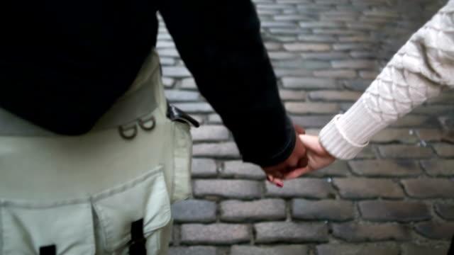 young couple holding hands - bekymmerslös bildbanksvideor och videomaterial från bakom kulisserna