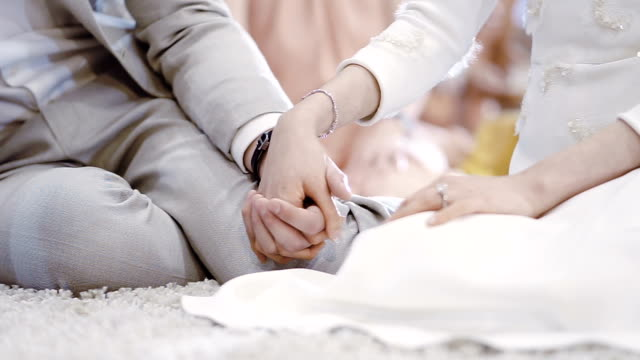 young couple holding hands - young couple wedding friends video stock e b–roll