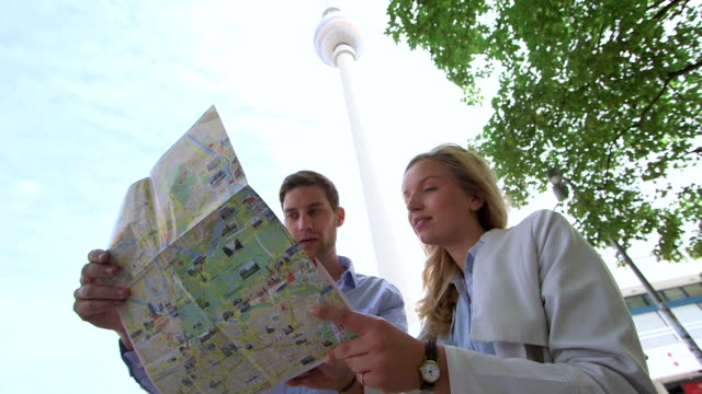 Young couple holding map video